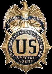 180px-DEA_badge_C