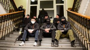 Pro-Russian protesters sit inside the seized regional administrative building in Kharkiv