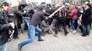 Pro-Russian protesters clash with activists supporting the territorial integrity of Ukraine as Interior Ministry members attempt to break them apart during rallies in Kharkiv
