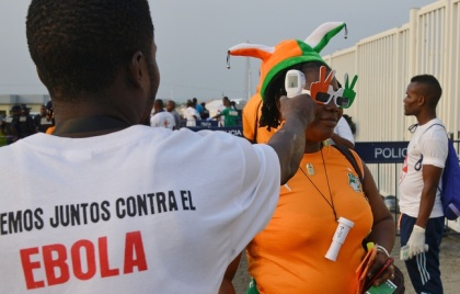 648x415_a-health-worker-checks-the-body-temperature-of-a-fan-as-part-of-an-ebola-screening-ahead-of-the-2015