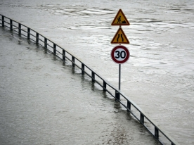 A street sign stands in the water on a flooded street by the river Seine in Paris, Wednesday, June 1, 2016. Paris City Hall closed roads along the shore of the Seine from the southwest edge of the city to the neighborhood around the Eiffel Tower as the water level has risen 4.3 meters (14 feet 1 inches) higher than usual. (AP Photo/Markus Schreiber)/MSC122/16153444243693/1606011431