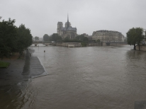View of the river Seine near the Notre Dame cathedral after its banks became flooded following heavy rainfalls on May 31, 2016 in Paris. France's weather agency Meteo France maintained today 18 departments under orange alert for heavy rainfalls, which have already disrupted transports in the northeastern part of the country. / AFP PHOTO / JOEL SAGET