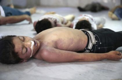 544346-a-view-shows-bodies-of-children-whom-activists-say-were-killed-by-gas-attack-in-the-ghouta-area-in-t