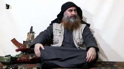 A bearded man with Islamic State leader Abu Bakr al-Baghdadi's appearance speaks in this screen grab taken from video